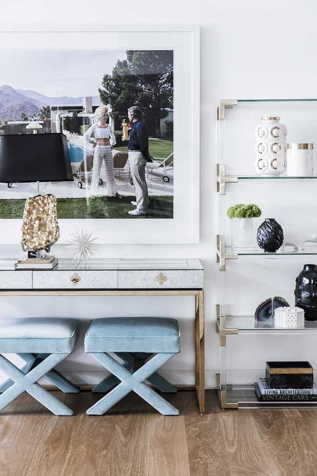 slim aarons print with lucite shelf and x benches
