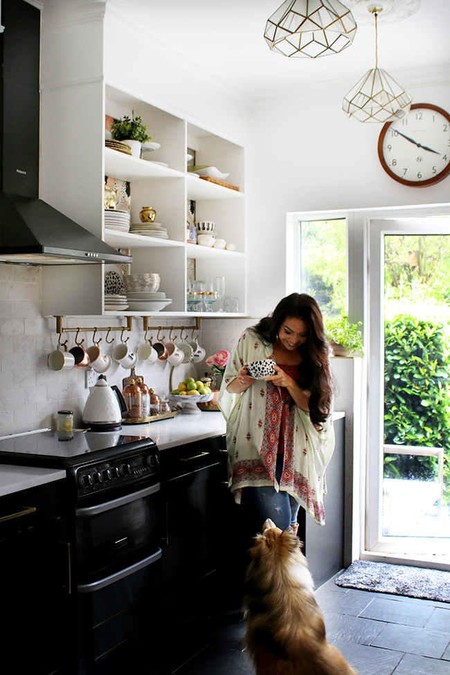 Kimberly Duran Swoon Worthy blog in her kitchen with her dog