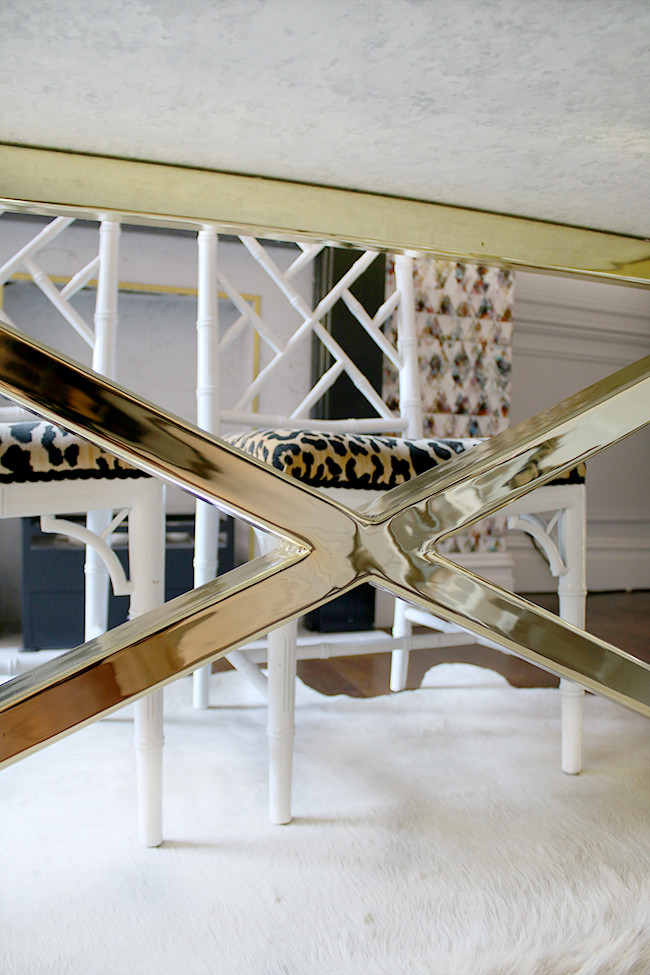brass table base with marble top