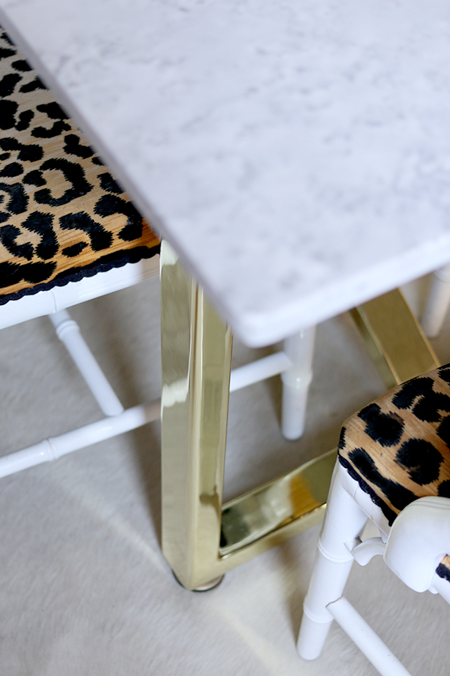 marble table top with brass legs