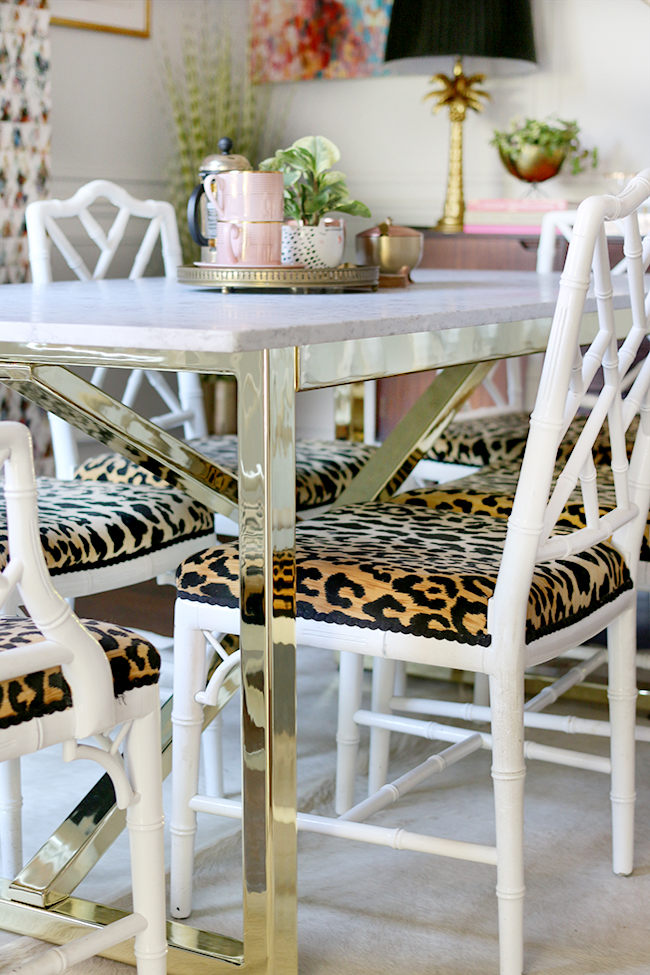 marble topped brass table bespoke custom furniture with white chippendale faux bamboo chairs and leopard print seats