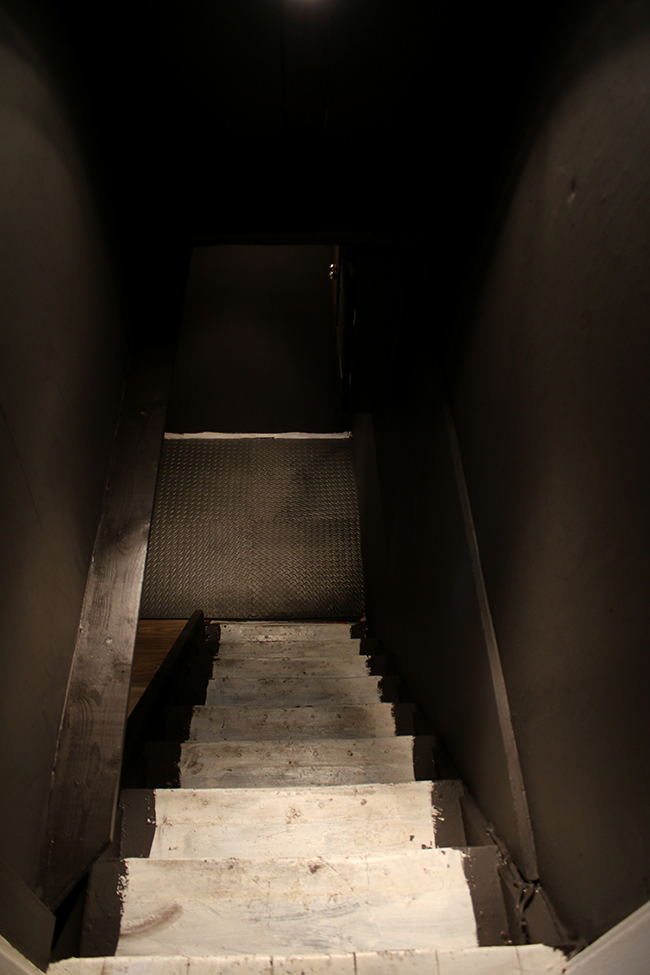 cellar stairway painted dark without stair runner - progress