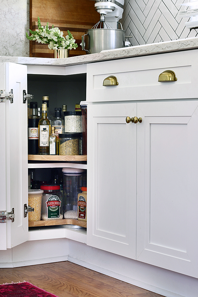 Using a Lazy Susan within a corner cabinet is a great way to utilise space within a small kitchen!