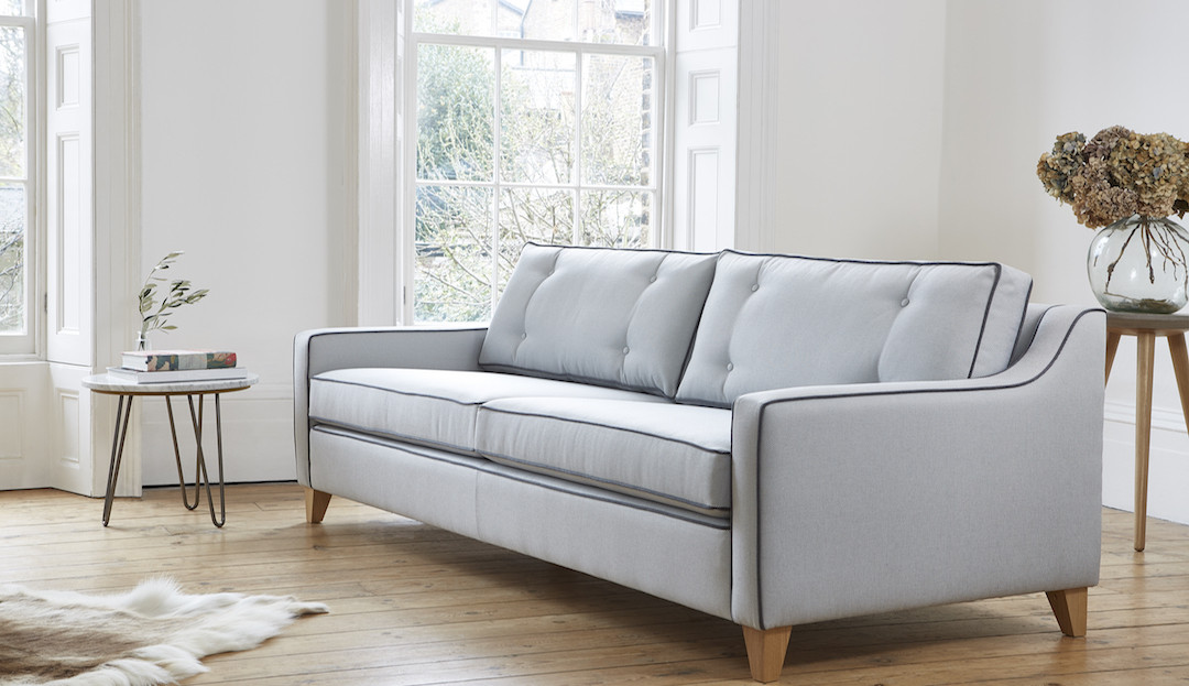 olivia_in_textured_weave_steel_with_midnight_piping_2 sofa by Darlings of Chelsea