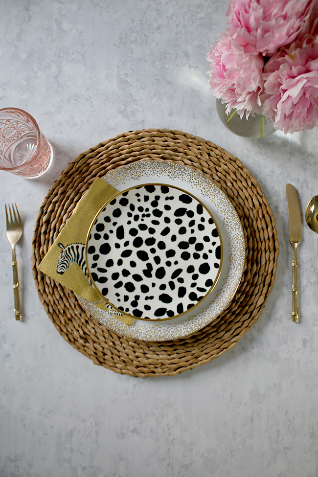 table setting mix and match natural and black and white polkadots with pink accents