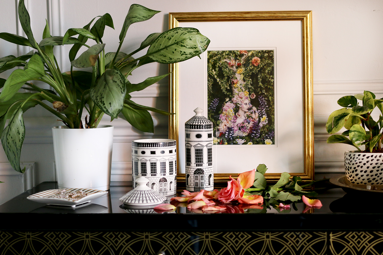 Fornasetti Architettura Scented Candle and room spray on black and gold console with plant