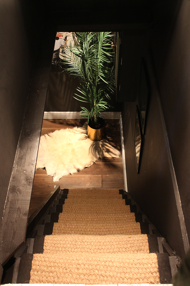 black stairs with coir runner
