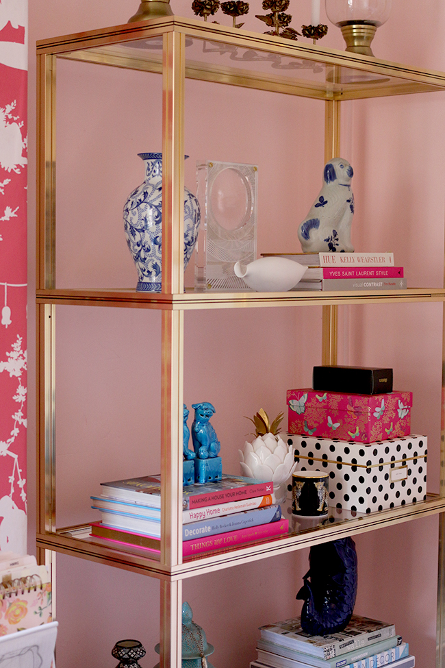 gold vintage brass shelving unit styling