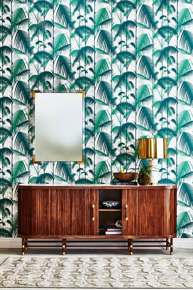 Lucite Mirror and sideboard with palm leaf wallpaper from Anthropologie