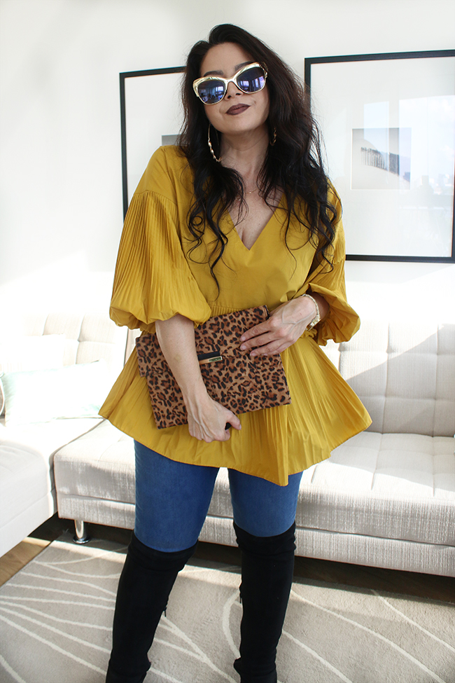 Mustard peplum top with skinny jeans and black leather jacket with over the knee boots