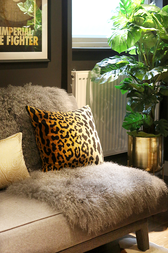 grey sofa with mongolian throw and leopard print cushion