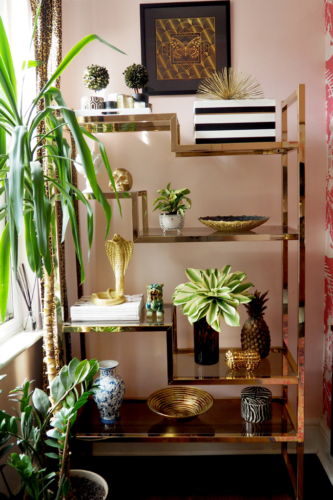 Brass and glass vintage shelving unit in pink office