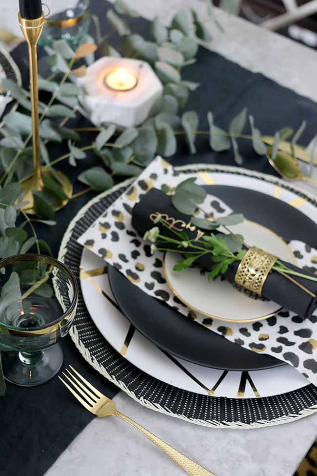 Adding the finishing touches to my Autumn tablescape in black white gold and green