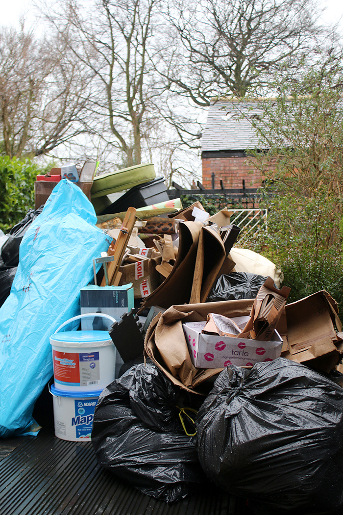 Clearabee Rubbish Removal Services - rubbish pile in back garden to be removed