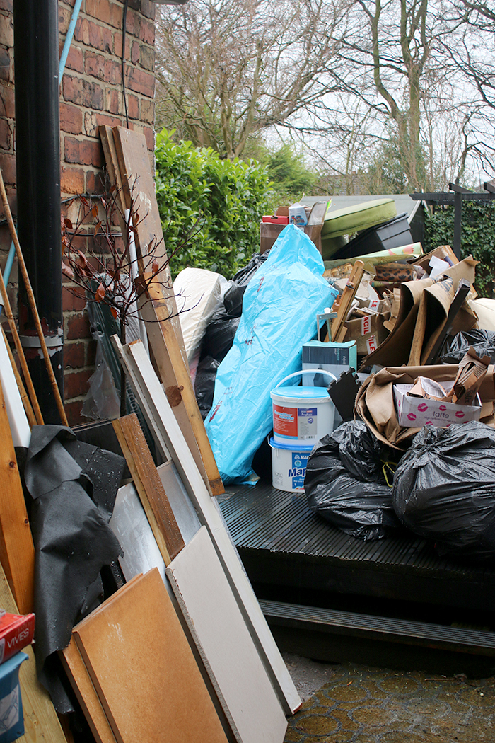 Clearabee Rubbish Removal Services - rubbish pile in side return to be removed