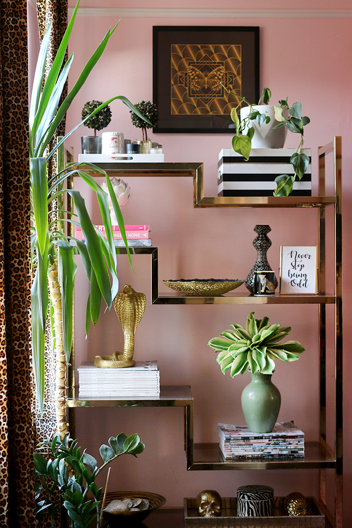 These are the 8 things every home office needs including a brass and glass vintage shelving unit