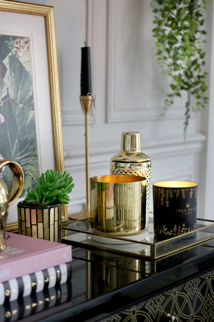 Tom Dixon Orientalist Candle and Sarah Miller London Candle vignette on black gloss with gold accessories