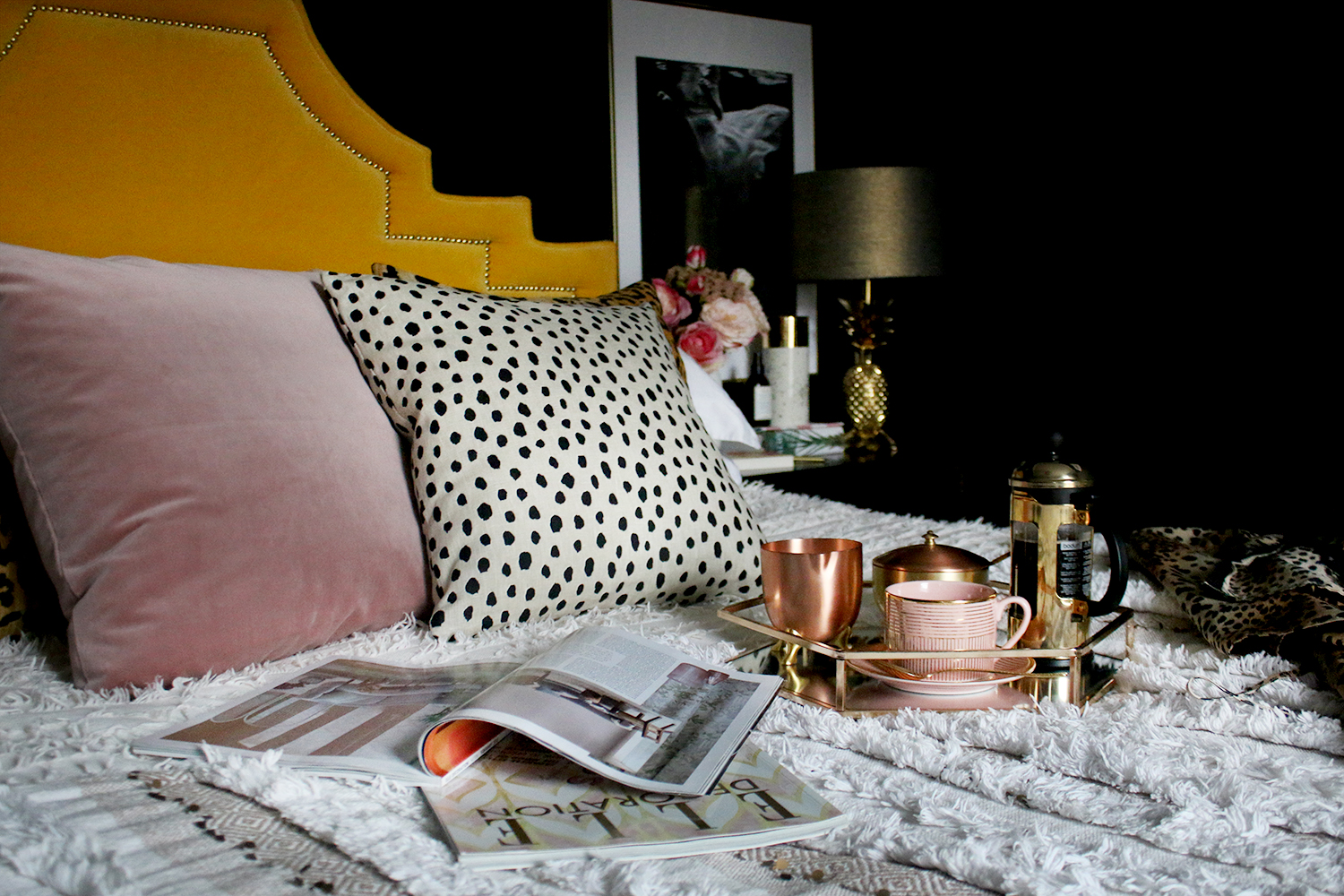 boho glam bedroom in black yellow and blush pink
