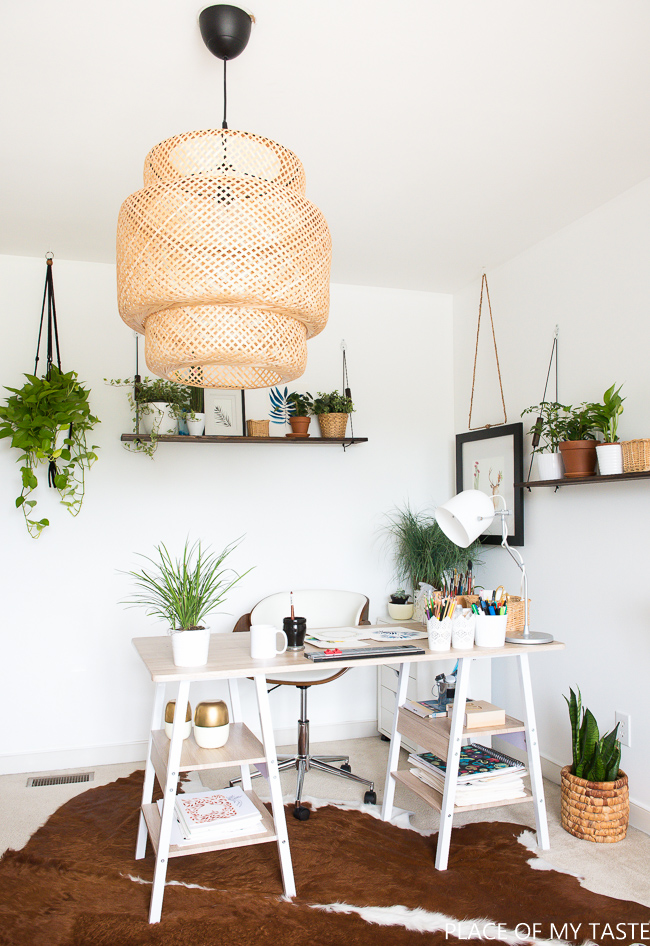 Work space surrounded by plants, check out the 8 things every home office needs!