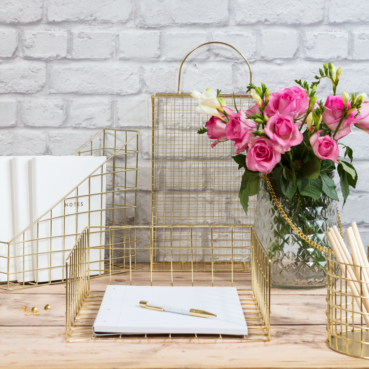 Do you have any work space essentials? Check out the 8 things every home office needs including pretty gold wire desk accessories