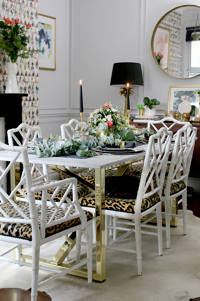 dining room table with brass base and marble top