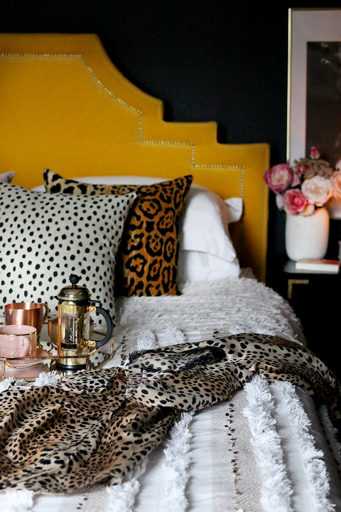 boho glam bedroom with leopard print accessories