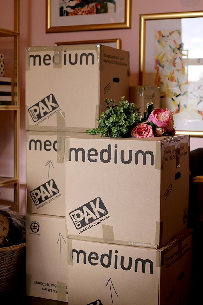 moving boxes with flowers on top