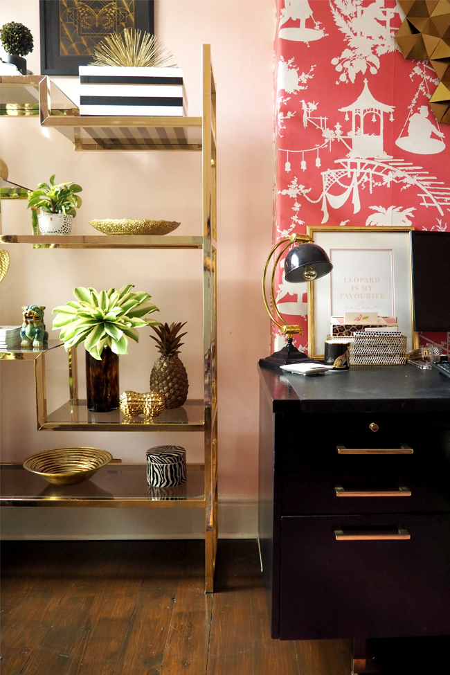 pink office with vintage glass shelving unit