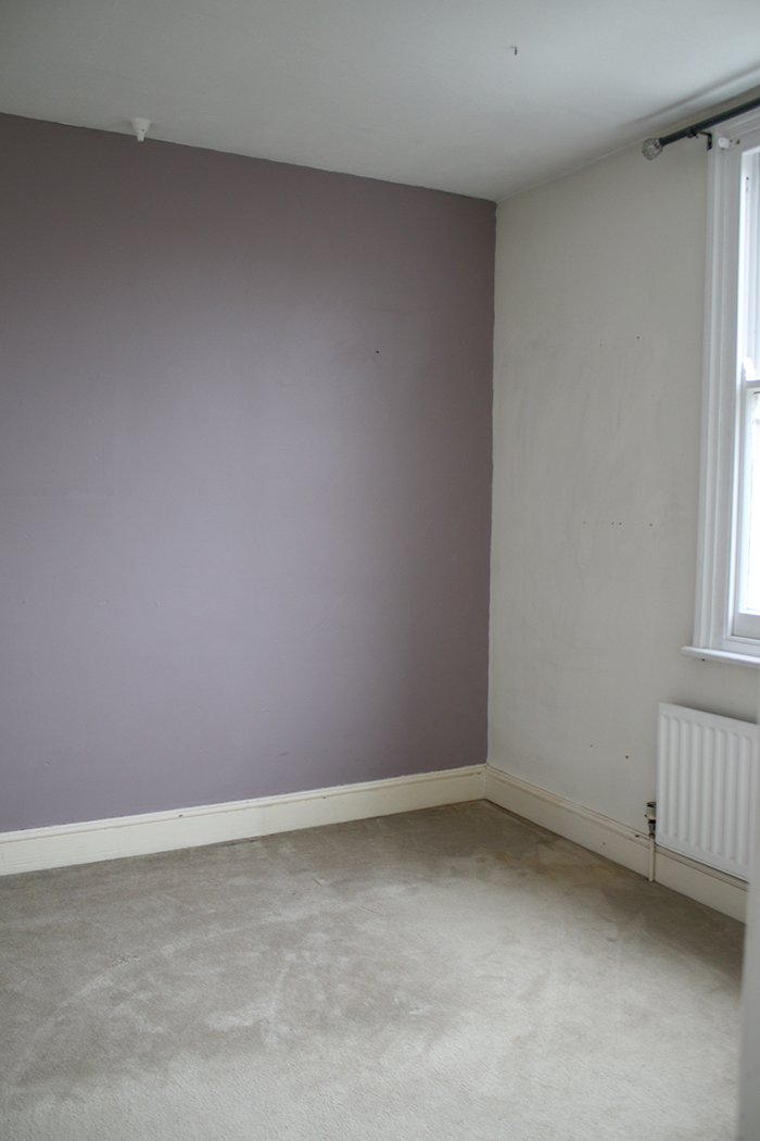 empty room with mauve feature wall