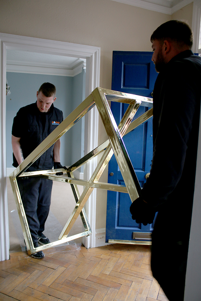 Moving brass table into place