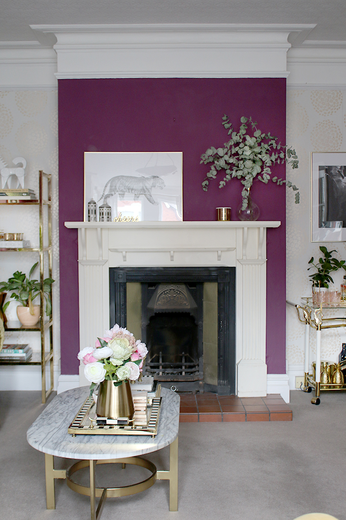 victorian fireplace styling in purple living room