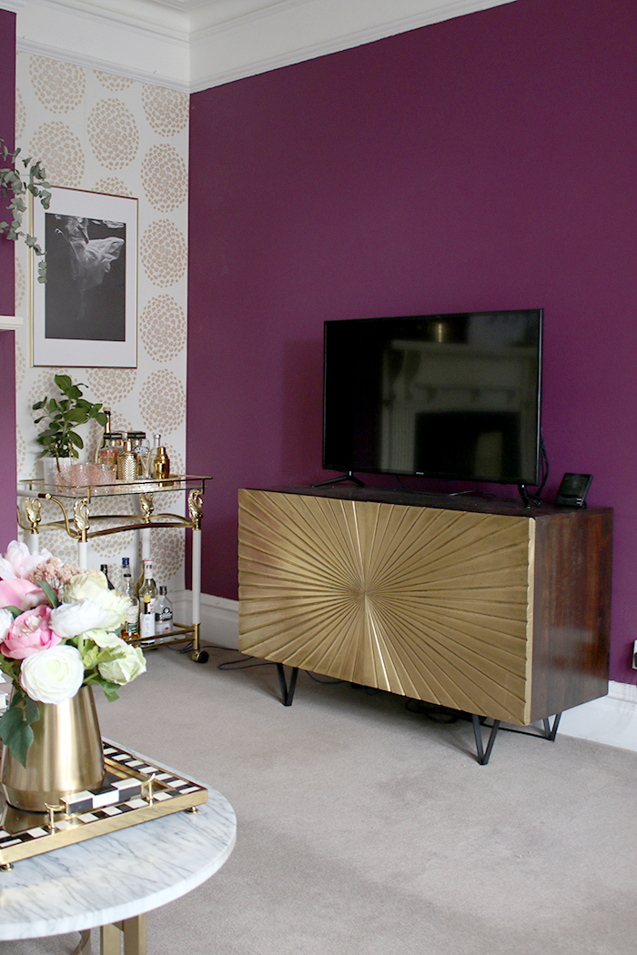tv in living room on gold sideboard