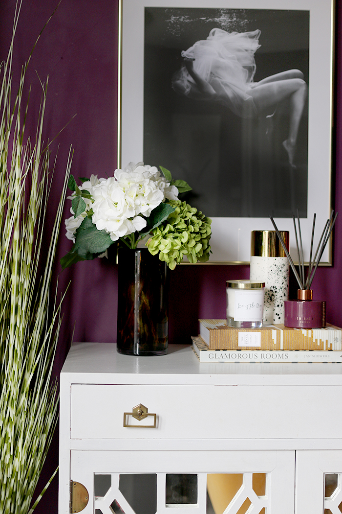 vintage cabinet vignette with flowers and candles