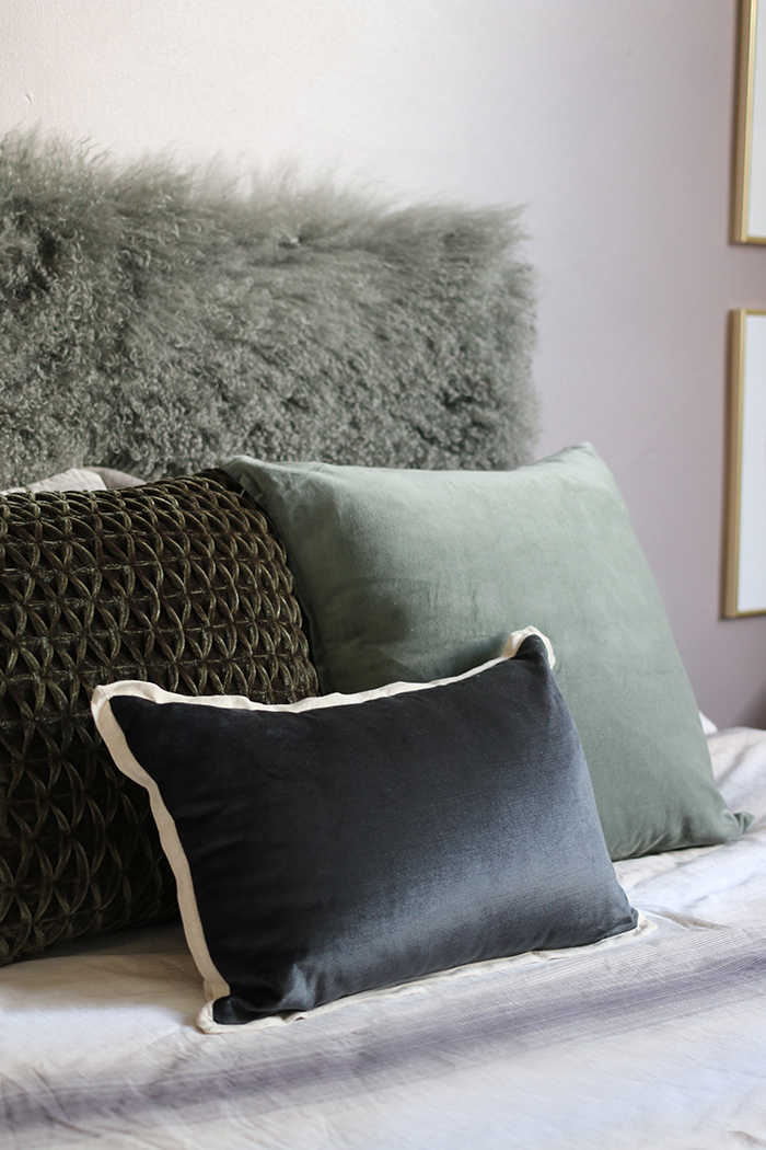 grey and green bedroom cushions in velvet