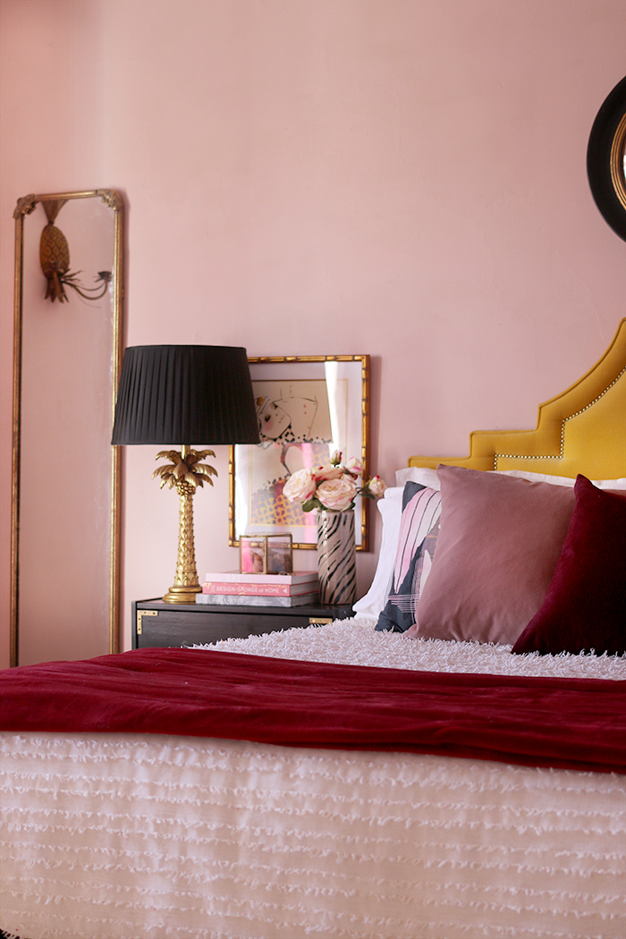 Farrow and Ball Calamine Paint in bedroom with accents of burgundy and blush pink