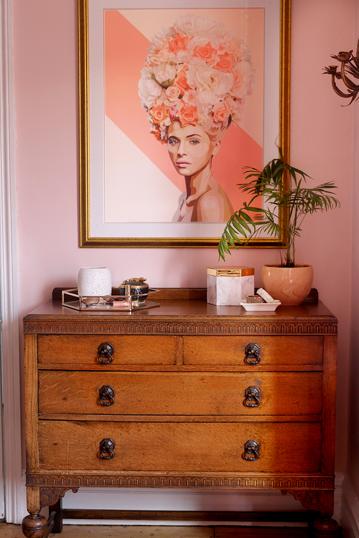 vintage chest of drawers with artwork in pink and peach
