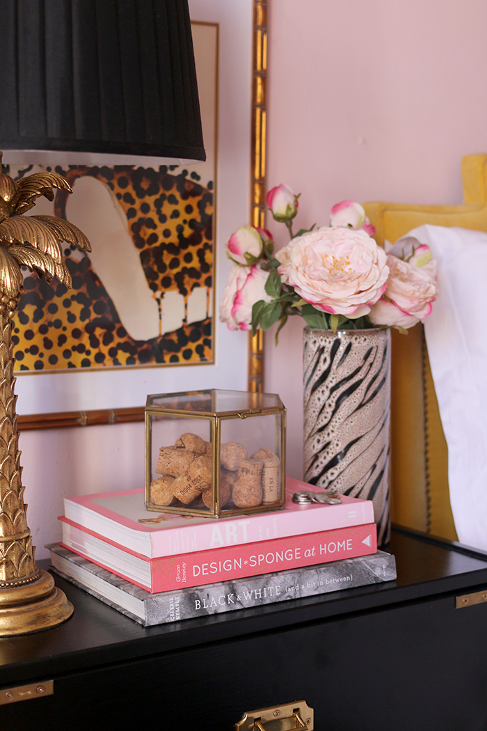 bedside table styling in pink, black and gold