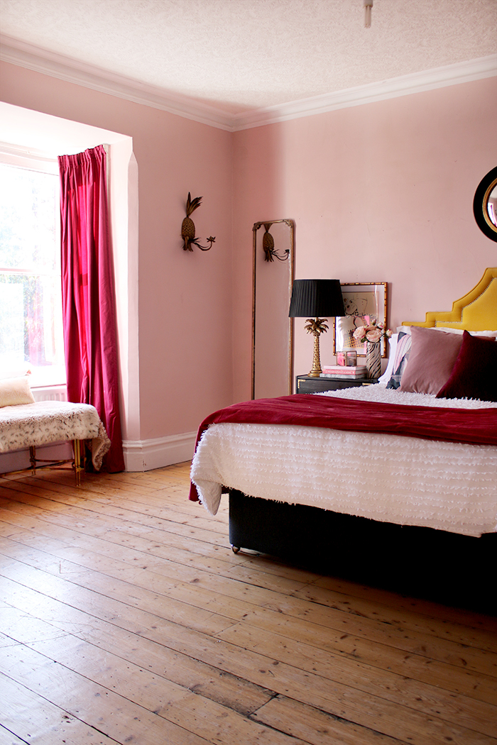 Farrow and Ball Calamine Paint in bedroom with accents of burgundy