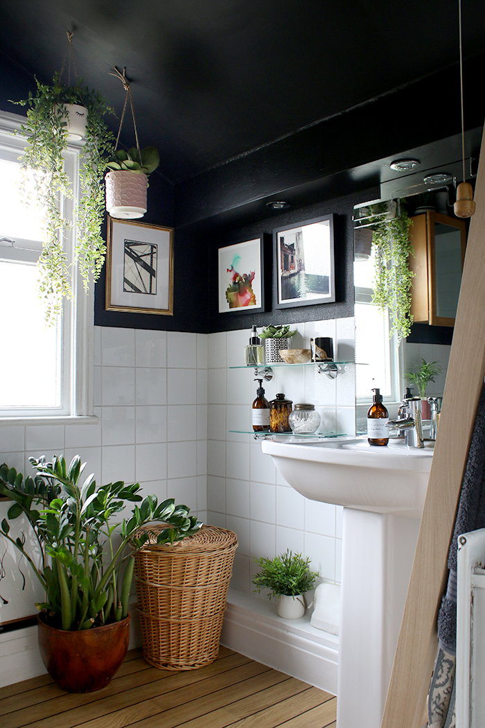 A look at my refreshed boho glam black bathroom with plants and wood and gold accents