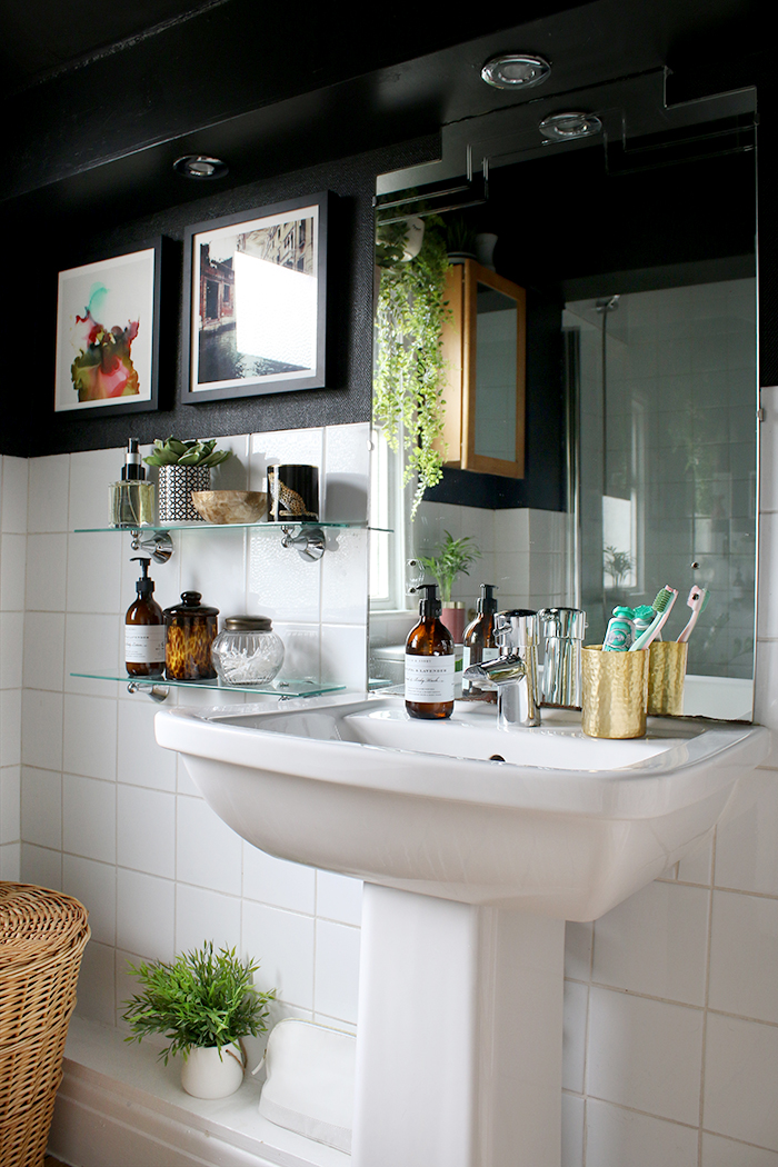 A closer look at the sink and shelf styling in my budget black bathroom