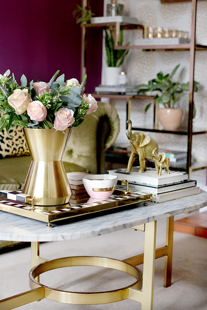Coffee table styling with fresh flowers and gold accents