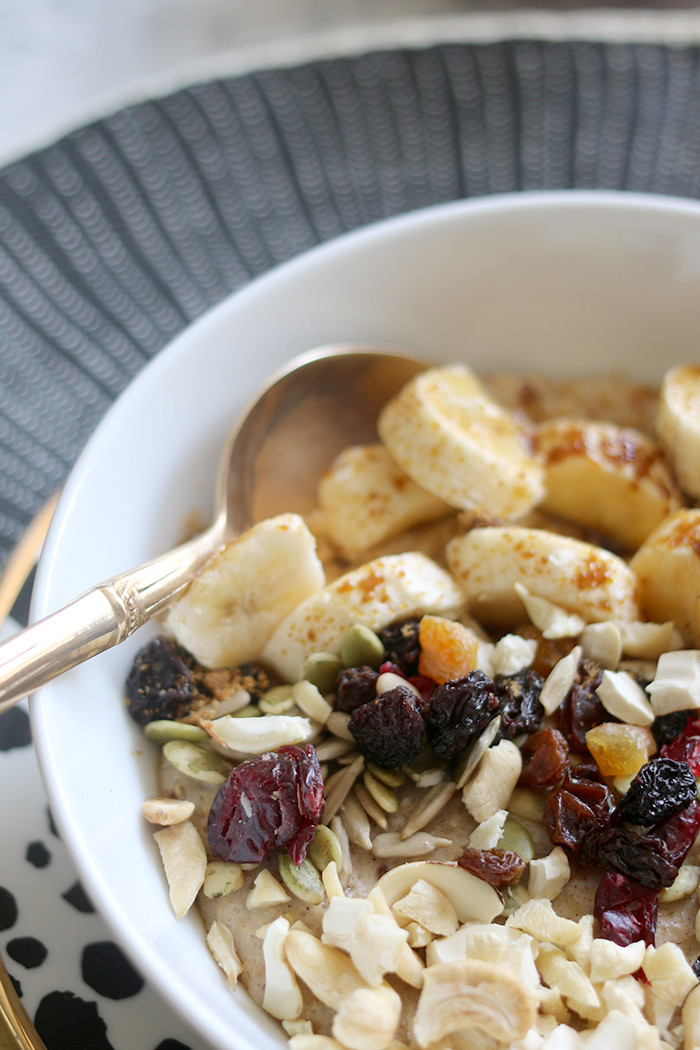 My go-to gluten free and dairy free healthy porridge recipe; nutty oats with bananas and dried fruit