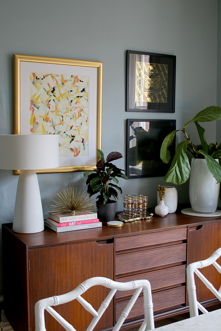 dining room mid-century sideboard styled with plants and art
