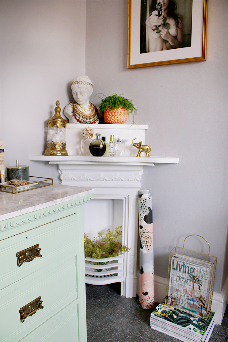 corner victorian fireplace styled with plants