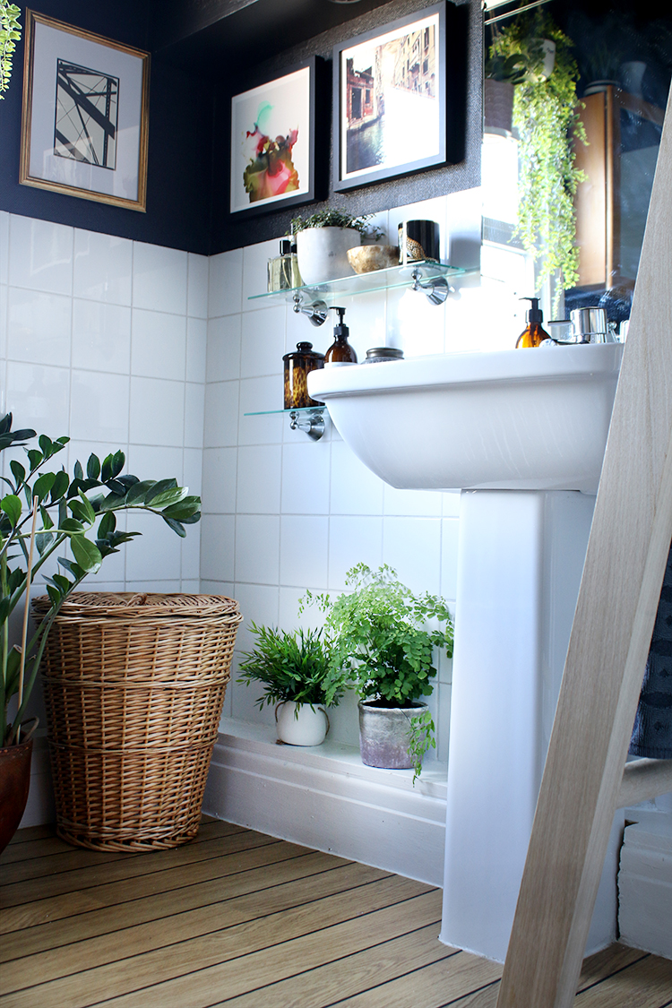 boho glam bathroom sink and shelf styling