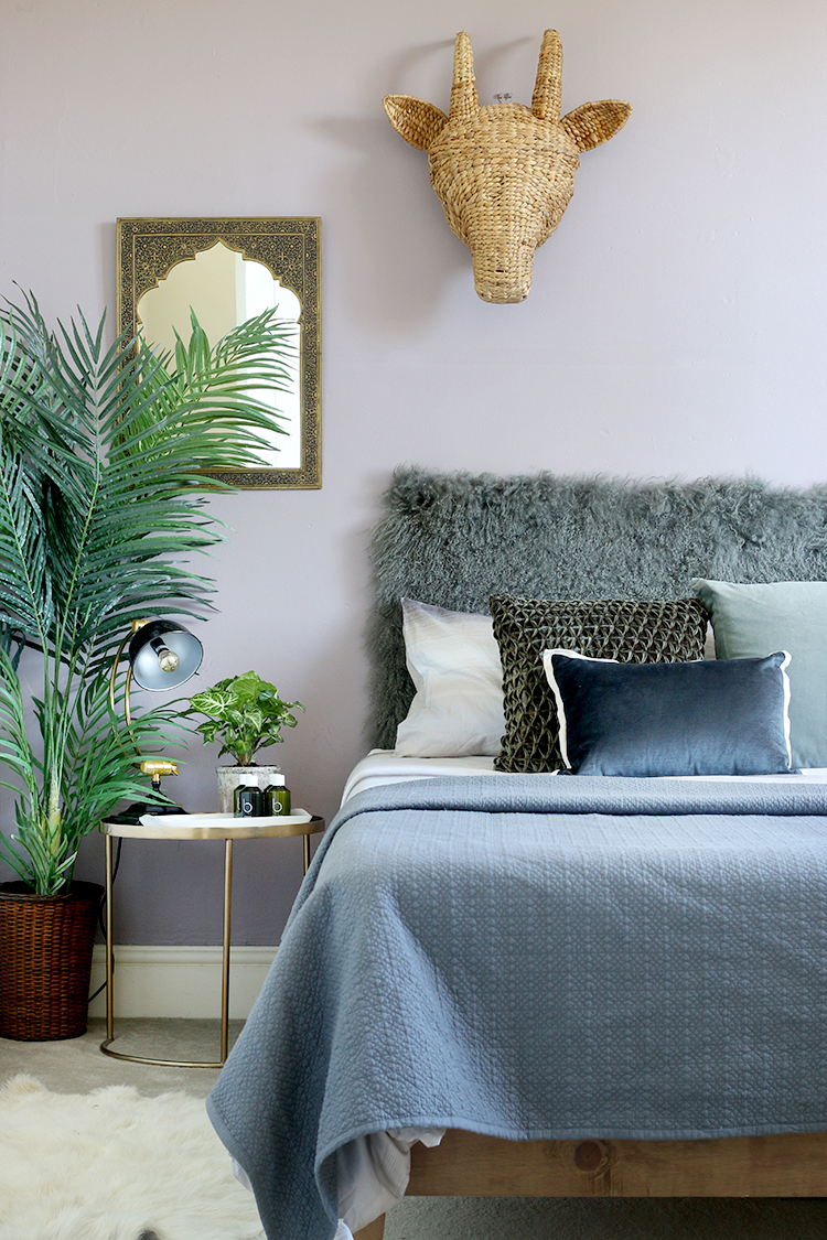 grey lilac and green guest bedroom with faux and real plants
