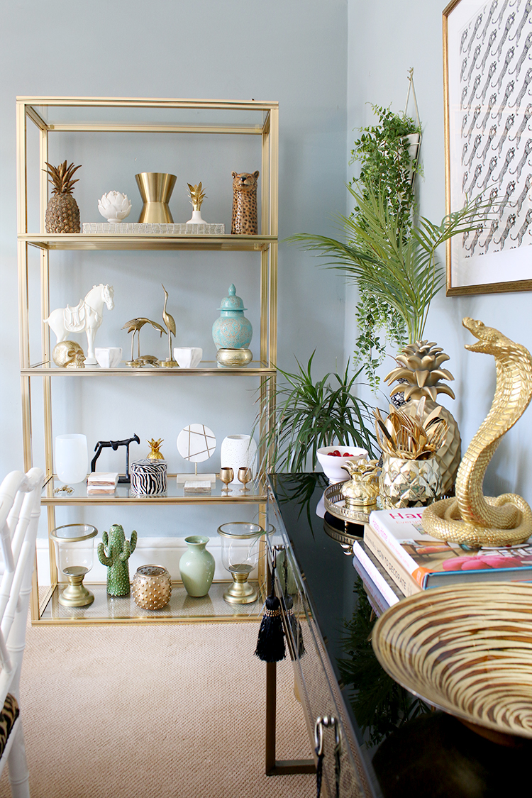 vintage gold and glass shelving unit