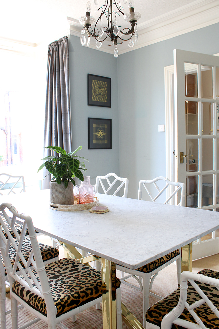 pale blue dining room with faux bamboo chairs