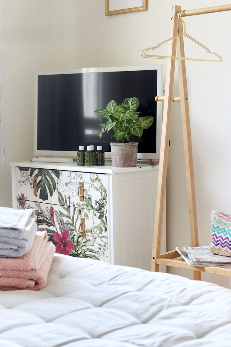 Having a TV and hanging rail is one of my tips to create the perfect guest bedroom