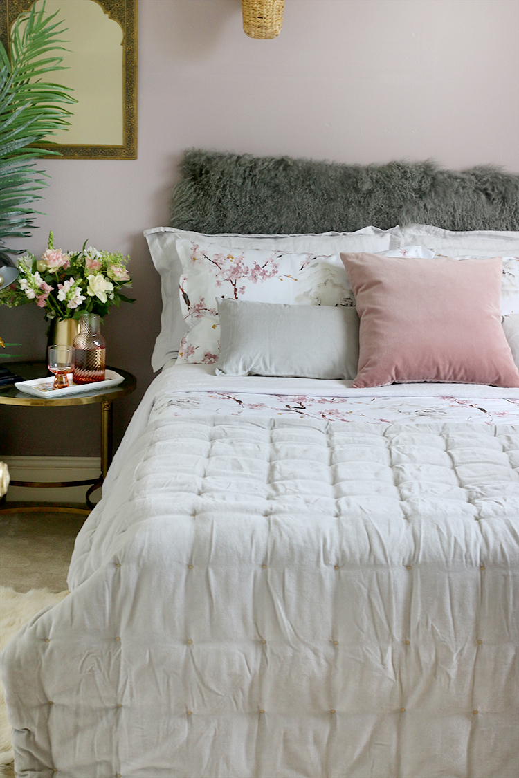 Guest bedroom with pink and grey bedding - How to Create the Perfect Guest Bedroom